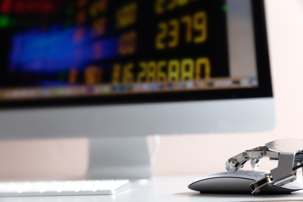 robot-hand-ordering-on-a-laptop-keyboard-an-exchange-trade-robot-trading-system-is-a-computer-trading_t20_axB7O6